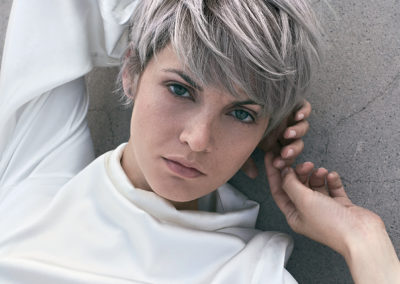 A girl with short grey hair