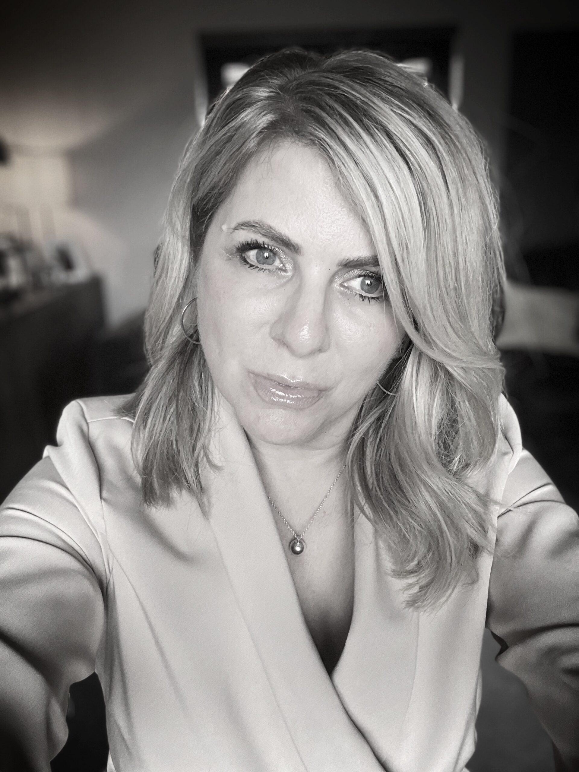 Charlotte Churchill smiling - the hair salon owner